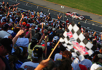 Apr 26, 2008; Talladega, AL, USA; NASCAR Nationwide Series driver Tony Stewart is cheered by the fans after winning the Aarons 312 at the Talladega Superspeedway. Mandatory Credit: Mark J. Rebilas-