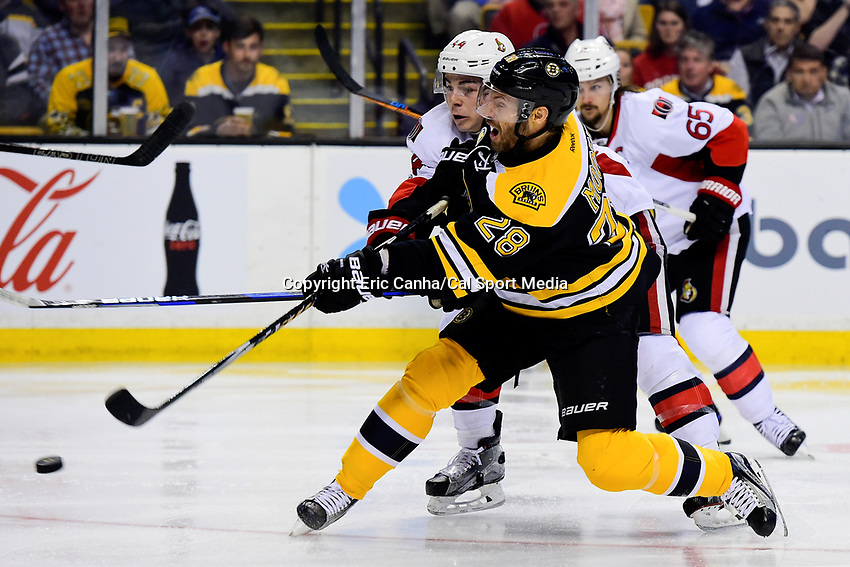 Tuesday, March 21, 2017: Ottawa Senators center Jean-Gabriel Pageau (44) tries to stop a shot by Boston Bruins center Dominic Moore (28) during the National Hockey League game between the Ottawa Senators and the Boston Bruins held at TD Garden, in Boston, Mass. Ottawa defeats Boston 3-2 in regulation time. Eric Canha/CSM