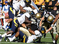 Huge pack of California defenders tackle Toney Clemons of Colorado during the game on Folsom Field at Boulder, Colorado on September 10th, 2011.  California defeated Colorado, 36-33 at overtime.