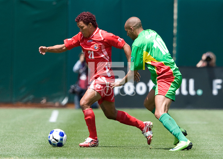 05 July 2009:  Amilcar Henriquez of Panama dribbles the ball away from Aurelien Capoue of Guadeloupe during the game at Oakland-Alameda County Coliseum in Oakland, California.   Guadeloupe defeated Panama, 2-0.