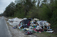 Debris from Luby Waters' house, which was flooded by Hurricane Florence, sits by the road in Warsaw, North Carolina Wednesday, November 14, 2018. (Justin Cook)
