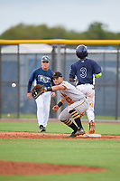GCL Pirates first baseman Kaleb Foster (23) stretches for a throw as Luis Arcendo (3) runs through the bag during a Gulf Coast League game against the GCL Rays on August 7, 2019 at Charlotte Sports Park in Port Charlotte, Florida.  GCL Rays defeated the GCL Pirates 5-3 in the second game of a doubleheader.  (Mike Janes/Four Seam Images)
