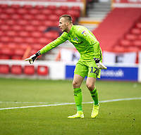 7th July 2020; City Ground, Nottinghamshire, Midlands, England; English Championship Football, Nottingham Forest versus Fulham; Marek Rodák of Fulham directs the pass back from his defender