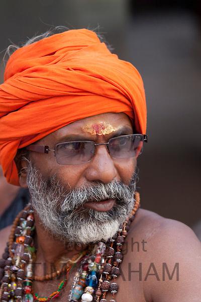 Hindu sadhu pilgrim with beads and turban in holy city of Varanasi, Benares, India