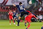 Tomiyasu Takehiro of Japan (L) fights for the ball with Khalid Al Braiki of Oman during the AFC Asian Cup UAE 2019 Group F match between Oman (OMA) and Japan (JPN) at Zayed Sports City Stadium on 13 January 2019 in Abu Dhabi, United Arab Emirates. Photo by Marcio Rodrigo Machado / Power Sport Images