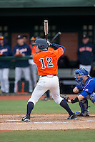 Charlie Cody (12) of the Virginia Cavaliers at bat against the Seton Hall Pirates at The Ripken Experience on February 28, 2015 in Myrtle Beach, South Carolina.  The Cavaliers defeated the Pirates 4-1.  (Brian Westerholt/Four Seam Images)