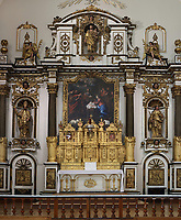 Altarpiece made from sculpted and gilded wood, 1723-39 by Pierre-Noel Levasseur, in the Chapel of the Ursuline Monastery, or Chapelle des Ursulines, Quebec City, Quebec, Canada. The Ursuline Convent was founded in 1639 and is the oldest girls' school on the continent. The chapel was built 1723-39 for the centennial of the arrival of the Ursulines in Quebec City. The building now houses a museum, the Musee des Ursulines de Quebec. The Historic District of Old Quebec is listed as a UNESCO World Heritage Site. Picture by Manuel Cohen