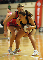 NZ's Temepara George takes the ball under pressure from Natasha Chokljat during the International  Netball Series match between the NZ Silver Ferns and World 7 at TSB Bank Arena, Wellington, New Zealand on Monday, 24 August 2009. Photo: Dave Lintott / lintottphoto.co.nz