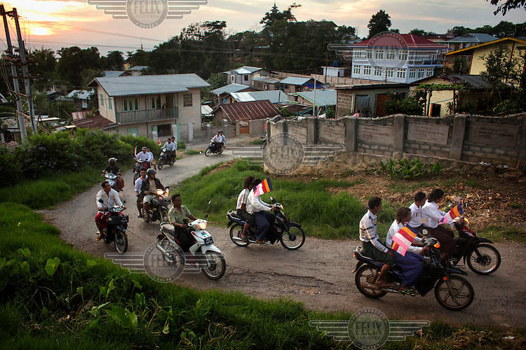 Followers of U Wirathu, the spiritual leader of the radical Buddhist 969 movement, accompany his convoy (unseen) on his way to deliver a sermon at Thein Taung Monastery in Taunggyi, Shan State. /Felix Features