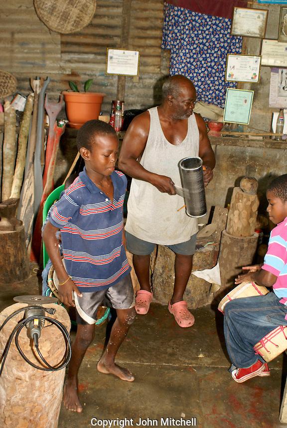 Man and his grandsons playing traditional Garifuna music in the Garifuna village of Triunfo de la Cruz, Honduras...