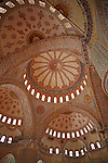 Intricate designs are painted onto the interior of the Blue mosque's domes in Istanbul, Turkey. Over 200 windows in these domes admit natural light into the prayer hall of the mosque.
