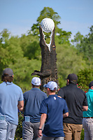 Avid golf fans walk past an alligator sculpture carved from a dead tree near the entrance during Round 2 of the Zurich Classic of New Orl, TPC Louisiana, Avondale, Louisiana, USA. 4/27/2018.<br /> Picture: Golffile | Ken Murray<br /> <br /> <br /> All photo usage must carry mandatory copyright credit (&copy; Golffile | Ken Murray)