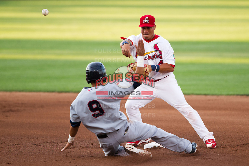Kolten Wong (4) of the Springfield Cardinals turns a double play during a game against the Arkansas Travelers at Hammons Field on June 13, 2012 in Springfield, Missouri. (David Welker/Four Seam Images).