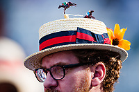 BALTIMORE, MD - MAY 19: A pair of horses chase each other around and around, atop this mans hat on Black-Eyed Susan Day at Pimlico Race Course on May 19, 2017 in Baltimore, Maryland.(Photo by Douglas DeFelice/Eclipse Sportswire/Getty Images)