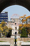 Photo shows the Peace Flame in the foreground and A-Bomb Dome in Hiroshima, Japan.