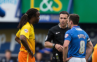 Referee Dean Whitestone has words with Marcus Bean of Wycombe Wanderers & Michael Doyle of Portsmouth during the Sky Bet League 2 match between Portsmouth and Wycombe Wanderers at Fratton Park, Portsmouth, England on 23 April 2016. Photo by Andy Rowland.