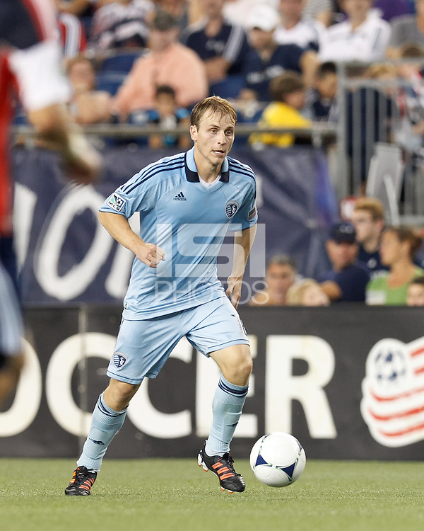 Sporting Kansas City defender Seth Sinovic (16) brings the ball forward. In a Major League Soccer (MLS) match, Sporting Kansas City defeated the New England Revolution, 1-0, at Gillette Stadium on August 4, 2012.