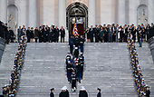The casket carrying former president George Herbert Walker Bush is carried up the steps of the US Capitol in Washington, Monday, Nov. 3, 2018.  President Bush who died at the age 94, will lie in state in the Capitol Rotunda until Wednesday morning.  (POOL PHOTO by Doug Mills/The New York Times)