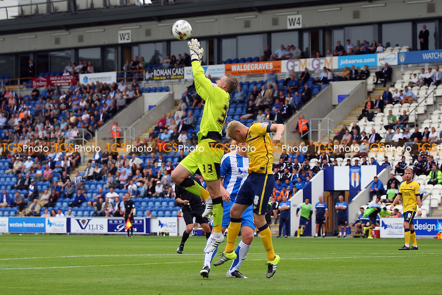 Elliott Parish of Colchester United comes out to take the aerial ball during Colchester United vs Scunthorpe United, Sky Bet League 1 Football at the Weston Homes Community Stadium, Colchester, England on 29/08/2015