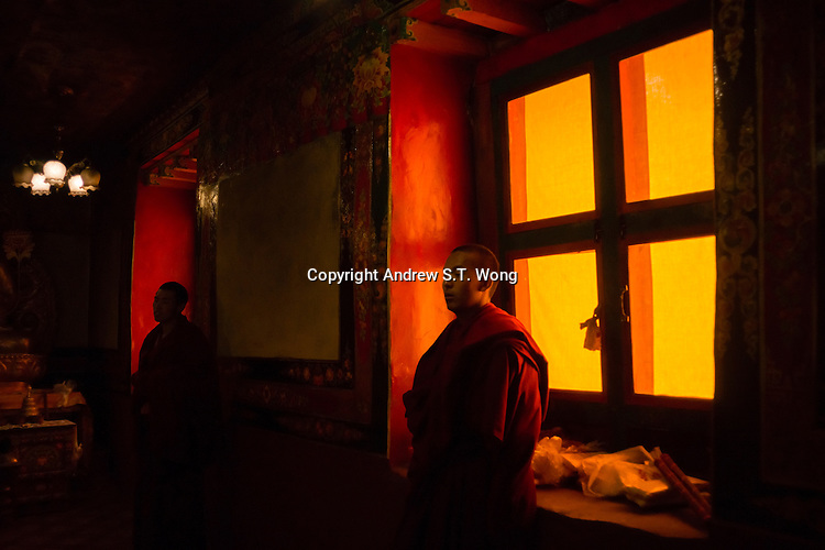 Bon monks guard religious relics at Menri Monastery, which is located 4,700 metres above sea level, in Namling county, Tibet, China, 2015. Menri is a leading Bon monastery in Tibet. The original Bon (Yungdrung Bon) was founded around 16,000 BC,  according to the followers who are called Bonpo. Today, Bon can be found in the more isolated parts of northern and western Tibet. According to the Chinese census, about 10% of Tibetans (about 100,000 people) follow Bon.