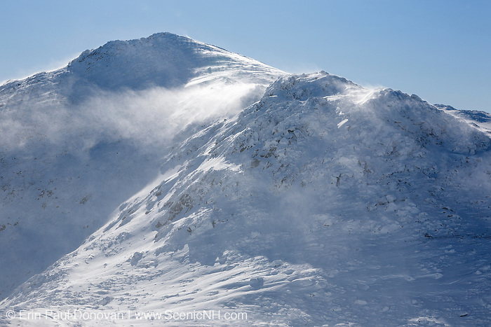 Strong winds cause snow to blow off the summit of Mount John Quincy Adams in the Presidential Range of the New Hampshire White Mountains during the winter months.