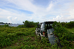 Orchid Island (蘭嶼), Taiwan -- Discarded car rusting away at the rodside.