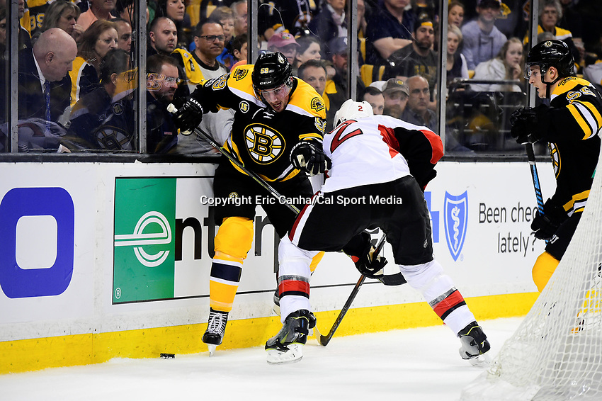 Monday, April 17, 2017: Boston Bruins left wing Tim Schaller (59) battles Ottawa Senators defenseman Dion Phaneuf (2) for the puck during game 3 of round one of the National Hockey League Eastern Conference Stanley Cup Playoffs between the Ottawa Senators and the Boston Bruins, held at TD Garden, in Boston, Mass. Ottawa defeats Boston 4-3 in overtime and leads the series 2-1. Eric Canha/CSM