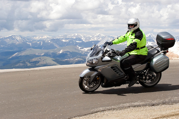 Motorcyclist on Mt Evans Road near Idaho Springs, Colorado. .  John offers private photo tours in Denver, Boulder and throughout Colorado. Year-round.