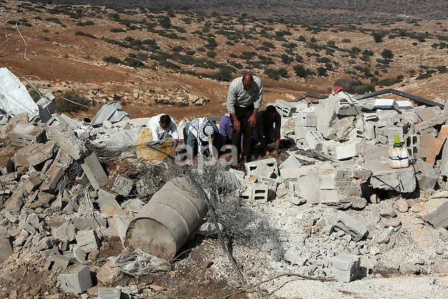 Palestinians pray on the rubble of a mosque which was demolished by the Israeli army in the West Bank village of Yarza near the West Bank town of Tubas, where the army destroyed at least five buildings due to lack of Israeli permits, Friday , Nov. 26, 2010. Photo by Wagdi Eshtayah