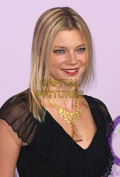 AMY SMART .18th Annual Environmental Media Awards held at the Ebell Theatre,  Los Angeles, California, USA, .13 November 2008..portrait headshot black gold necklace red lipstick .CAP/ADM/CH.©Charles Harris/AdMedia