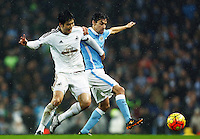 Jesus Navas of Manchester City and Ki Sung-Yueng of Swansea City during the Barclays Premier League match between Manchester City and Swansea City played at the Etihad Stadium, Manchester on December 12th 2015