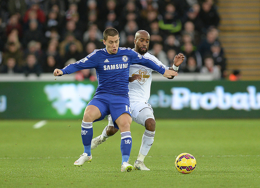 Chelsea's Eden Hazard battles with Swansea City's Dwight Tiendalli<br /> <br /> Photographer /Ashley CrowdenCameraSport<br /> <br /> Football - Barclays Premiership - Swansea City v Chelsea - Saturday 17th January 2015 - Liberty Stadium - Swansea<br /> <br /> &copy; CameraSport - 43 Linden Ave. Countesthorpe. Leicester. England. LE8 5PG - Tel: +44 (0) 116 277 4147 - admin@camerasport.com - www.camerasport.com