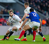 10th February 2019, Twickenham Stadium, London, England; Guinness Six Nations Rugby, England versus France; Elliot Daly of Englandtakes the ball towards Geoffrey Doumayrou of France