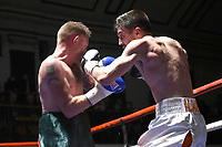 Lewis Adams (white shorts) defeats Michael Mooney during a Boxing Show at York Hall on 14th April 2018