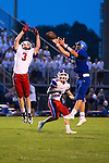 LCA's Nick Whitman goes up for a ball as Christian Academy Dylan Shouse (3) defends.  Lexington Christian Academy hosted Christian Academy of Louisville on Saturday August 23, 2014 in Lexington, Ky.  Photo by Mark Mahan