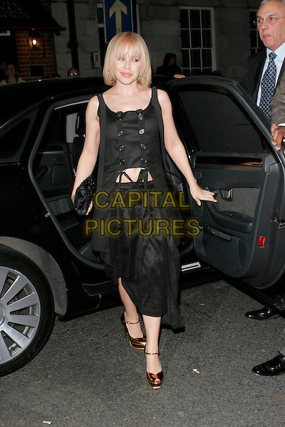 KYLIE MINOGUE .Finch and Partners Pre-Bafta Party held at Mark's Club, Mayfair, London, England. .February 9th 2008.full length buttons top peep toe shoes skirt straps belly stomach midriff.CAP/AH.©Adam Houghton/Capital Pictures.