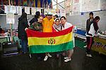 """Minamisanriku, Miyagi, Japan - Volunteers from Bolivia with national flag at Minamisanriku Volunteer Center, one year after the tsunami. The Latin group of volunteers """"Todos con Japon"""" visits Miyagi area during this Golden Week."""