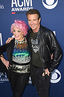 LAS VEGAS, NV - APRIL 7: Tanya Tucker and Dennis Quaid attend the 54th Annual ACM Awards at the Grand Garden Arena on April 7, 2019 in Las Vegas, Nevada. <br /> CAP/MPIIS<br /> &copy;MPIIS/Capital Pictures