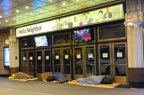 NEW YORK, NY - MARCH 24: Homeless seen sleeping through the evening at Times Square Church during the coronavirus pandemic in New York City on March 24, 2020. <br /> CAP/MPI/RMP<br /> ©RMP/MPI/Capital Pictures
