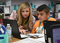 NWA Democrat-Gazette/J.T. WAMPLER Anna Shaw, math teacher at Kelly Middle School in Springdale, helps student Jose Vazquez Wednesday Nov.6, 2019. Shaw is one of four Arkansas teachers, including three from Northwest Arkansas, who were selected as recipients of the Presidential Awards for Excellence in Mathematics and Science Teaching.