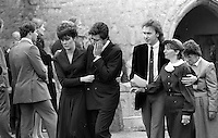 Pix: Copyright Anglia Press Agency/Archived via SWpix.com. The Bamber Killings. August 1985. Murders of Neville and June Bamber, daughter Sheila Caffell and her twin boys. Jeremy Bamber convicted of killings serving life...copyright photograph>>Anglia Press Agency>>07811 267 706>>..Jeremy Bamber is comforted by his girlfriend Julie Mugford at the funeral of his family, alongside Colin Caffell, father and husband of victims. no date..ref 0006 neg 18