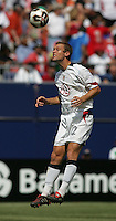 July 24, 2005: East Rutherford, NJ, USA:  USMNT defender Jimmy Conrad (12) heads the ball back to the goalkeeper during the CONCACAF Gold Cup Finals at Giants Stadium.  The USMNT won 3-1 on penalty kicks.