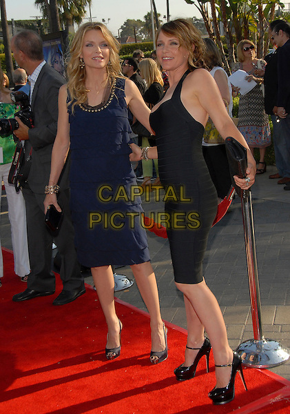 "MICHELLE PFEIFFER & DEEDEE PFEIFFER.at The Paramount Pictures L.A. Premiere of ""Stardust"" held at Paramount Studios in Hollywood, California, USA,.July 29 2007..full length sisters family black navy blue dress ruffles YSL Tribute pumps ankle strap platform heels shoes                                                .CAP/DVS.©Debbie VanStory/Capital Pictures"