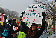 January 26, 2013  (Washington, DC)  A woman holds a pro gun-control sign during the March on Washington for Gun Control, lead by D.C. Mayor Vincent Gray and D.C. Council members. (Photo by Don Baxter/Media Images International)