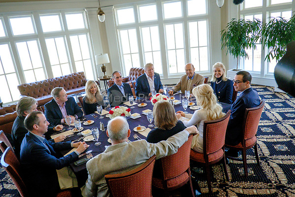United States President Donald Trump has a working lunch with staff and cabinet members and significant others at his golf course, Trump National Golf Club in Potomac Falls, Virginia, U.S., on Saturday, March 11, 2017.  Seated around the table from left: Assistant to the President and White House Chief Strategist Steve Bannon; White House Chief of Staff Reince Priebus; White House Press Secretary Sean Spicer; Merle Bari Shulkin; US Secretary of Veterans Affairs David Shulkin; President Trump; US Secretary of Commerce Wilbur Ross; Hilary Geary Ross; US Secretary of the Treasury Steven Mnuchin; Louise Linton; Karen Hernest Kelly; and US Secretary of Homeland Security John F. Kelly. <br /> Credit: Pete Marovich / Pool via CNP /MediaPunch