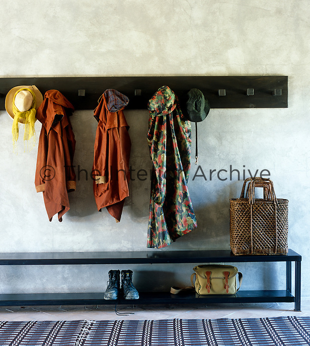 A smart iron bench and Shaker-style coat rack in the hall