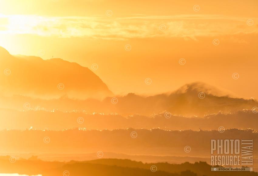 Mesmerizing rolling big waves at sunset, Pua'ena Point, Hale'iwa, North Shore, O'ahu.