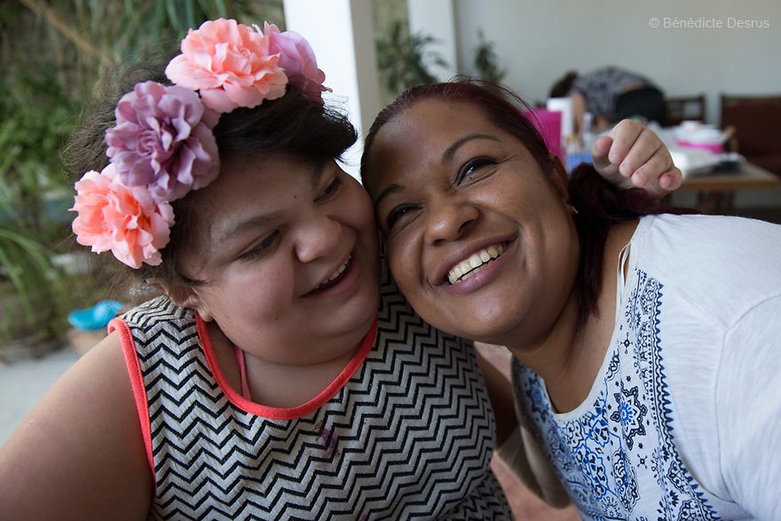 """Ana Ximena Navarro (L) and her aunt Gabriela Rios Ballesteros (R), are pictured in Guadalajara, Mexico on February 22, 2017. Ximena was diagnosed as an infant with Hurler syndrome. Hurler syndrome is the most severe form of mucopolysaccharidosis type 1 (MPS1), a rare lysosomal storage disease, characterized by skeletal abnormalities, cognitive impairment, heart disease, respiratory problems, enlarged liver and spleen, characteristic facies and reduced life expectancy. Ximena was being given enzyme replacement therapy (ERT) when she was 19 months old, and she was suddenly able to eat and sleep. She is now 12, and has normal hormonal development for her age, although some mental delay, according to her father. """"Without the treatment, she would have died from all the complications — untreated, children have a very bad quality of life and typically die before they are seven"""", her father says. Photo credit: Bénédicte Desrus"""