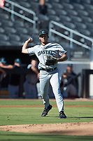 Coastal Carolina Chanticleers starting pitcher Zach McCambley (39) makes a throw to first base against the Duke Blue Devils at Segra Stadium on November 2, 2019 in Fayetteville, North Carolina. (Brian Westerholt/Four Seam Images)