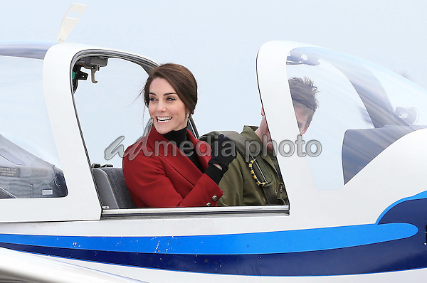 14 February 2017 - Princess Kate Duchess of Cambridge is seen inspecting a training plane during a visit to the RAF Air Cadets at RAF Wittering in Stamford, Lincolnshire.  The Duchess of Cambridge is Royal Patron and Honorary Air Commandant of the Air Cadet Organisation. Photo Credit: ALPR/AdMedia